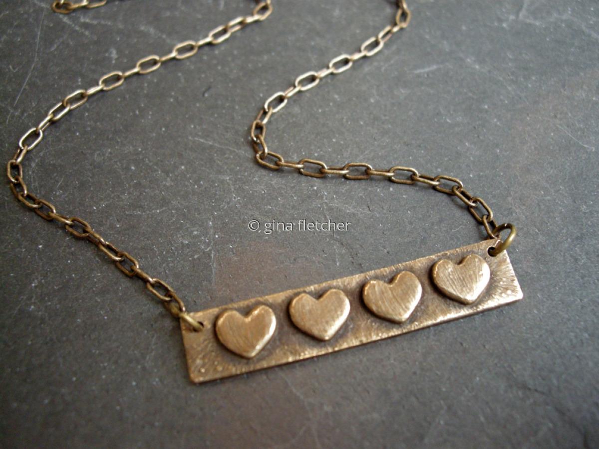 n e c k l a c e . . . bronze . . . 4 hearts . . . #665 (large view)