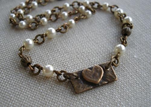 necklace . . . tiny heart . . . bronze