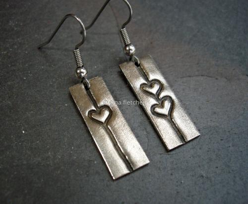 e a r r i n g s . . . white copper . . . hearts