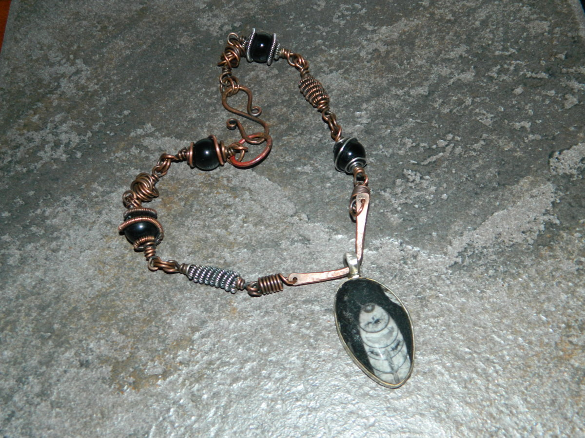 Black stone and wire wrapped beads. (large view)