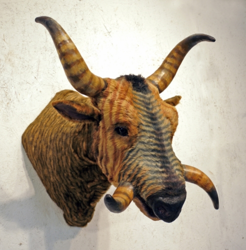 sculpture of a horned and tusked bovine (large view)