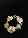 STERLING SILVER HAND FABRICATED ART JEWELRY BRACELET WITH DYED ALUMINUM STONES AND TOGGLE CLASP (thumbnail)