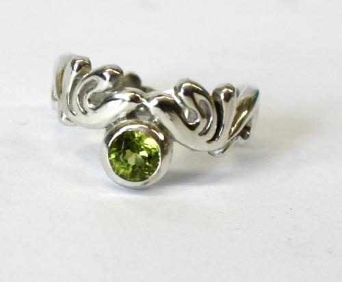 Silver and peridot ring
