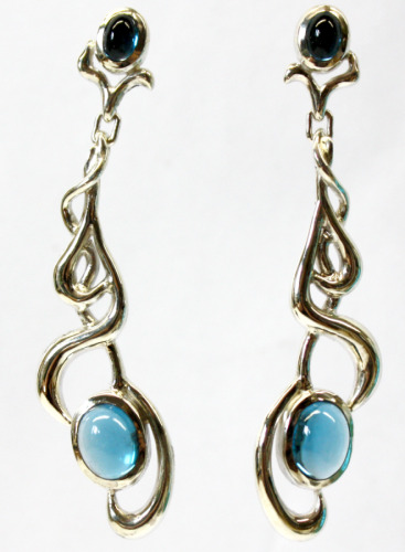 Silver earrings with blue topaz cabs