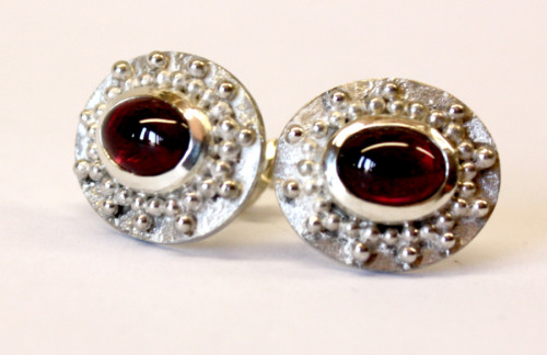 Silver and garnet studs with granulation