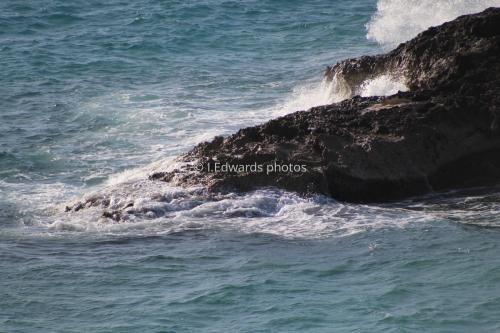 Ocean waves against a rock