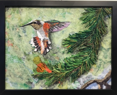 Hummingbird in Pines (large view)