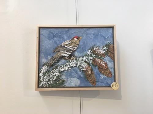 Framed Klinglet in pines (large view)