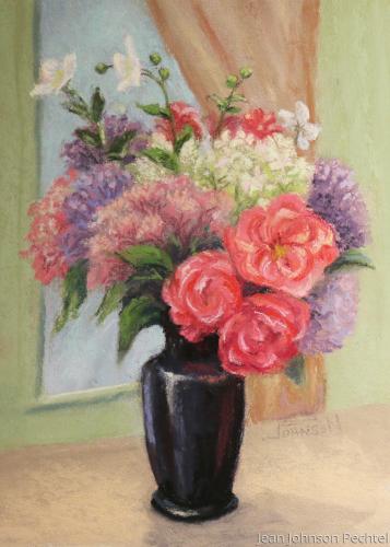 Coral Roses in Black Vase