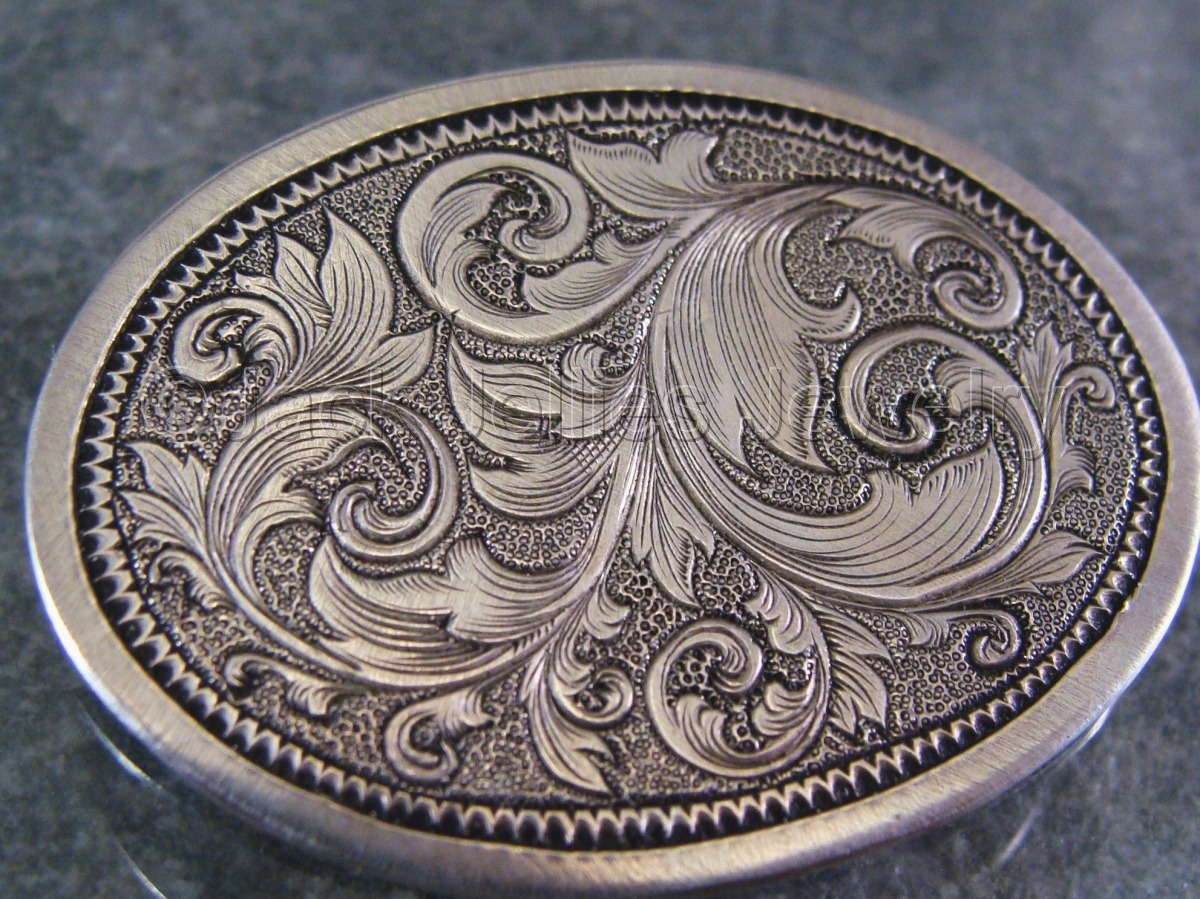 An art nouveau scrollwork design hand engraved into 20 gauge sterling silver. (large view)