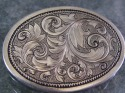 An art nouveau scrollwork design hand engraved into 20 gauge sterling silver. (thumbnail)