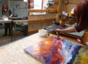 Jerrie Sasson painting in her Pontiac Michigan Studio with Encaustics (thumbnail)