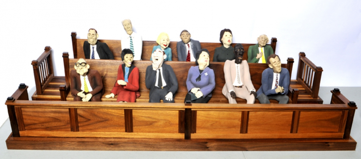 Twelve jurors, eight male and four female, are all seated in a beautifully crafted hardwood jury box.  Perfect for lawyers and judges.  Different apparel, body language, and facial expressions create an overview of everyday people doing their civic duty. (large view)