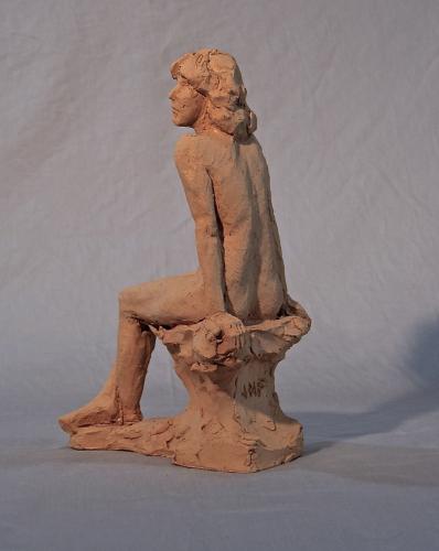 small seated figure