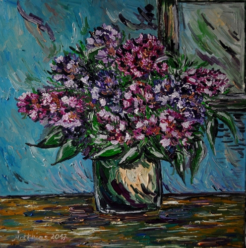 Lilacs on table with window