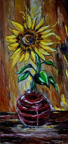 Single sunflower in red vase