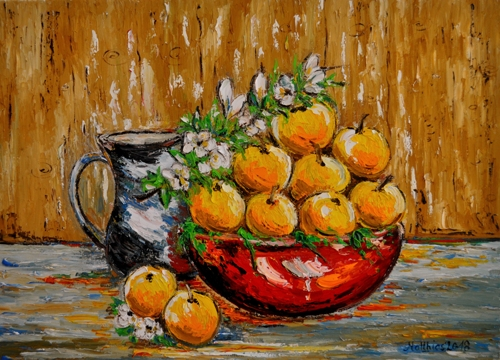 Yellow Apples in red Bowl