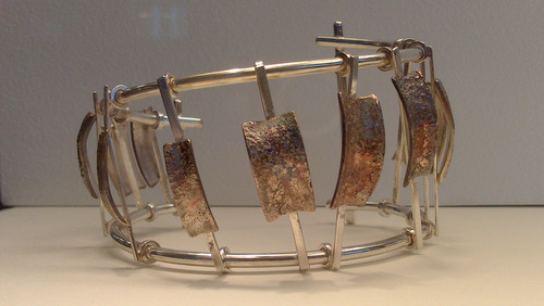 Scoliosis Bracelet. Sterling Silver. Shibuichi. Individual vertebrae move on the side rails. (large view)