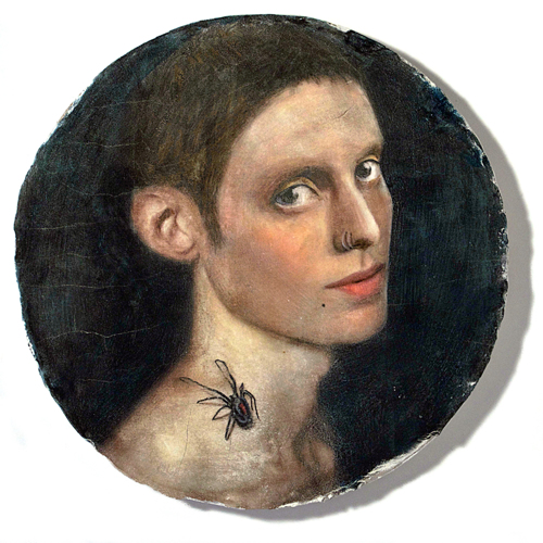 YOUNG PERSON WITH SPIDER TATTOO