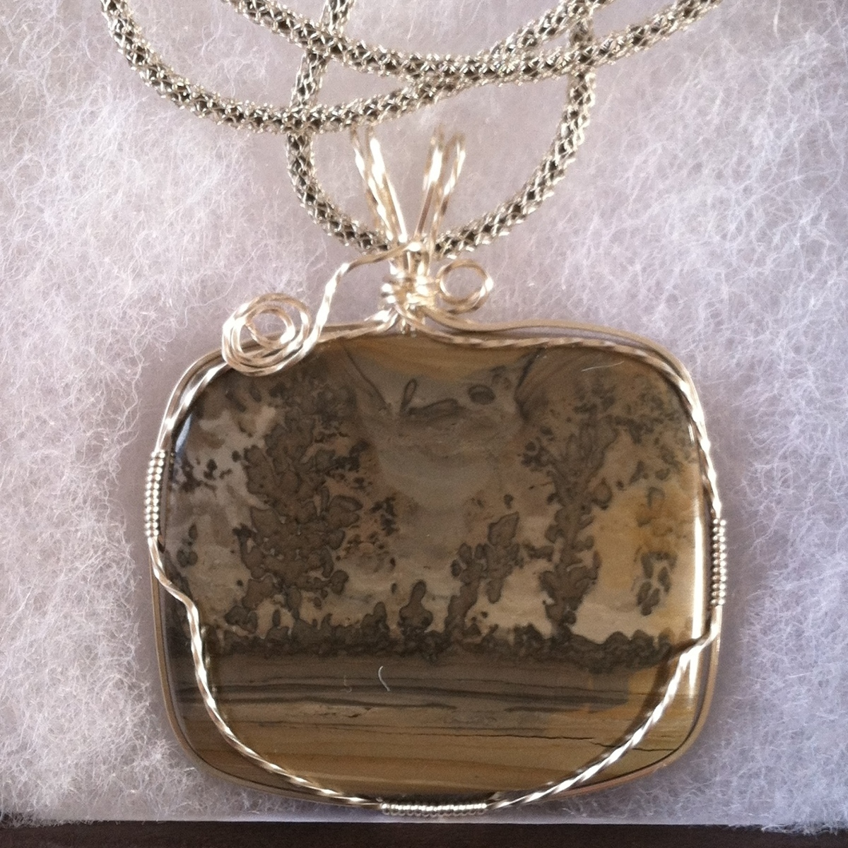 Rhyolite pendant, silver wrapped (large view)