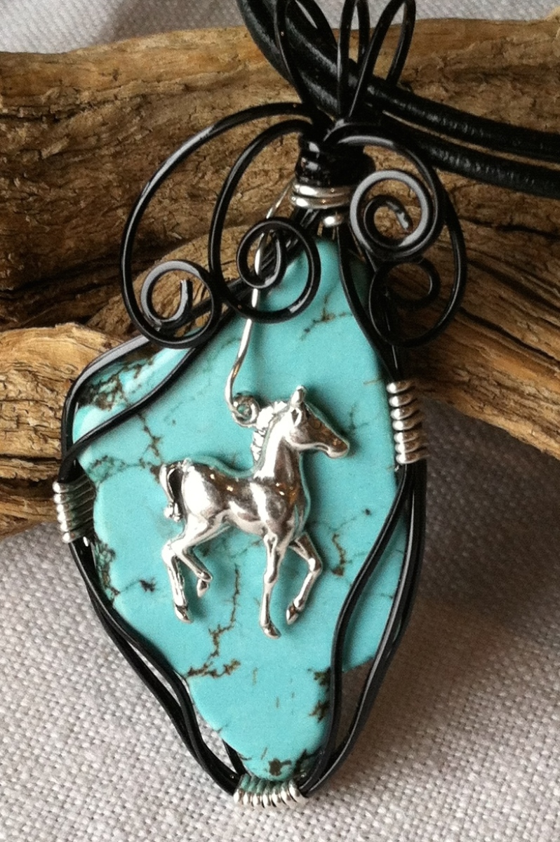 Silver foal on Turquoise slab  (large view)