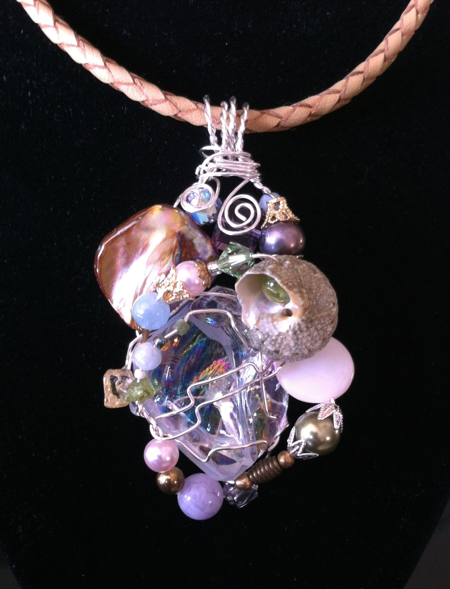 Irridescent crystal wrapped with pearls, seashells (large view)