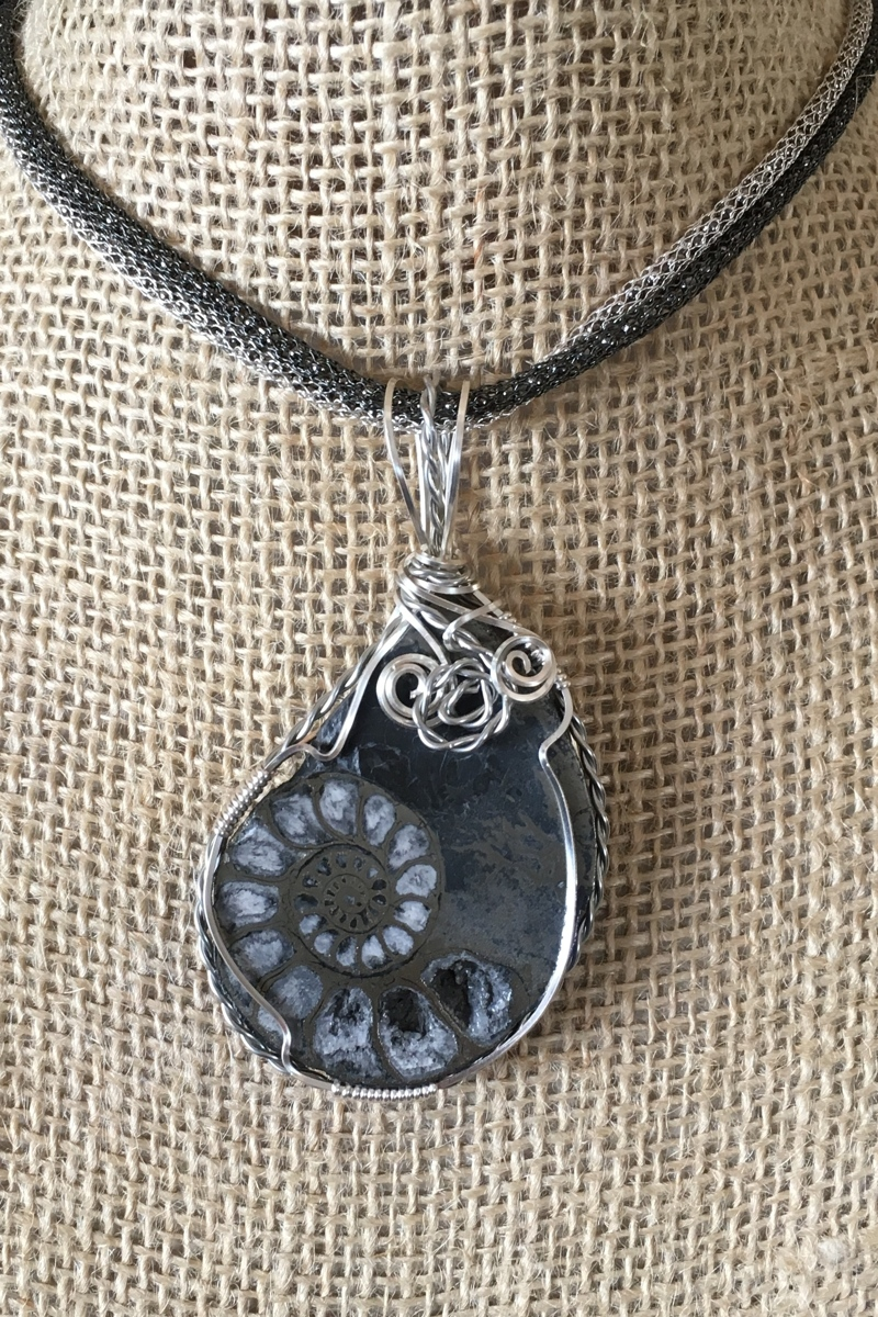 Pyritized ammonite, wrapped (large view)