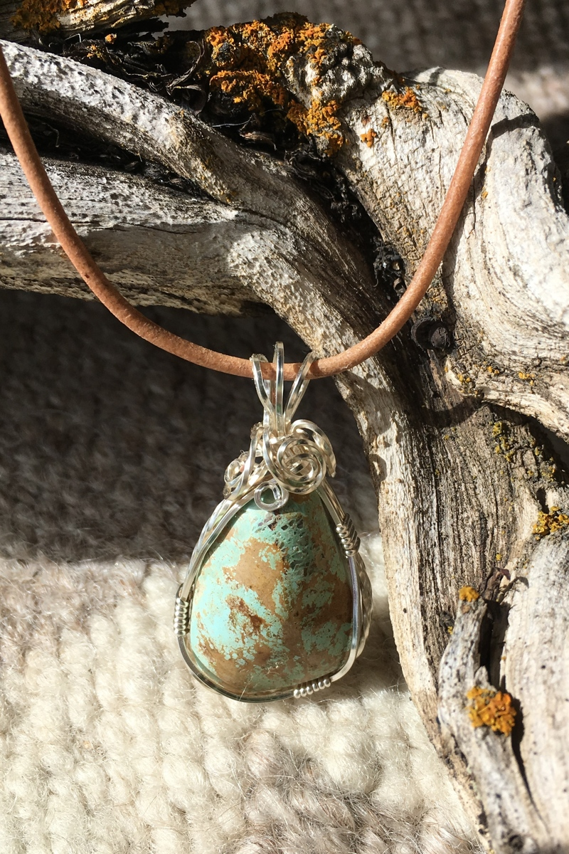 Turquoise and silver on leather (large view)