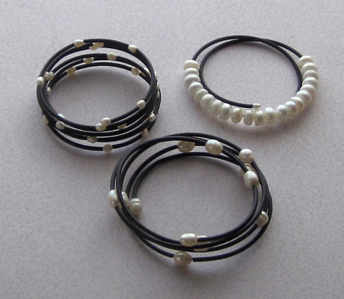 Pearl and black rubber bracelets
