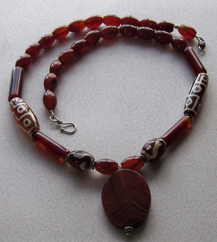 Carved red agate necklace