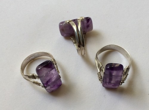 Double drilled amethyst ring