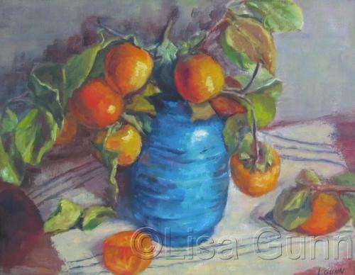Persimmons in blue vase