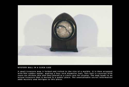 MYSTERY BALL, IN CLOCK CASE