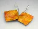 Textured, lightweight aluminum earrings in autumnal oranges and golds with sterling silver ear wires. (thumbnail)