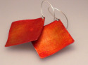 Textured, lightweight aluminum earrings in autumnal orangeswith sterling silver ear wires. (thumbnail)