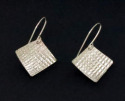 "Embossed, square sterling silver earrings sparkle in the light. With sterling silver ear wires. Available in 3 sizes 1/2"" x 1/2"", 3/4"" x 3/4"", 1"" x 1"". (thumbnail)"