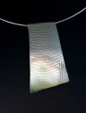 "Embossed Sterling Silver Slide sparkles in the light 2""l x 1 1/4"" w can be worn on a cord, chain or neck wire. (thumbnail)"