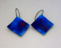 Square titanium earrings, hung from titanium wires at a diagonal. Heat, by means of a small torch is used to produce this vivid, iridescent blue color Available in 3 sizes (thumbnail)