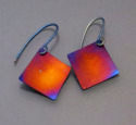 Square titanium earrings, hung from titanium wires at a diagonal. Heat, by means of a small torch is used to produce this vivid, iridescent copper with blueaccents. Available in 3 sizes (thumbnail)