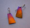 Titanium earrings, hung from titanium wires Heat, by means of a small torch is used to produce this vivid, iridescent copper with blue accents. (thumbnail)