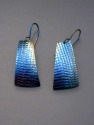 Titanium earrings, hung from titanium wires Heat, by means of a small torch is used to produce this vivid, blue with white accents. (thumbnail)