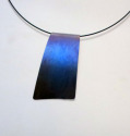 Titanium slide, hung from coated steel neck wire Heat, by means of a small torch is used to produce this vivid, blue color. (thumbnail)