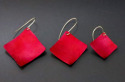 Red aluminum earrings hung on the diagonal from hand made sterling silver ear wires available in 3 sizes (thumbnail)