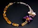 A collaboration neck piece between Louise Rauh and Bethany young. Two handpainted aluminum flowers places dividing a strand of large citrine and mixed gemstone beads ans a double strand of fresh water pearls interspersed with gemstone beads. (thumbnail)
