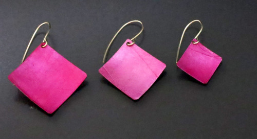 Lightweight, pink aluminum square earrings are positioned at a diagonal and hung from sterling silver wires. Available in 3 sizes. (thumbnail)