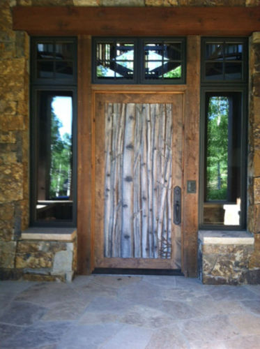 Aspen tree entry door carving (large view)
