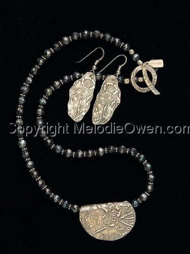 Textured silver  with pearls