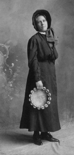Woman with tambourine early 1900s