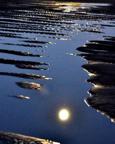 Full moon on wet sand