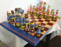Handmade and painted chess set with board. (thumbnail)